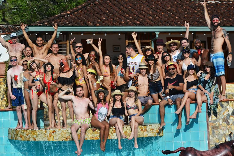 Group of people standing by pool at finca in Colombia