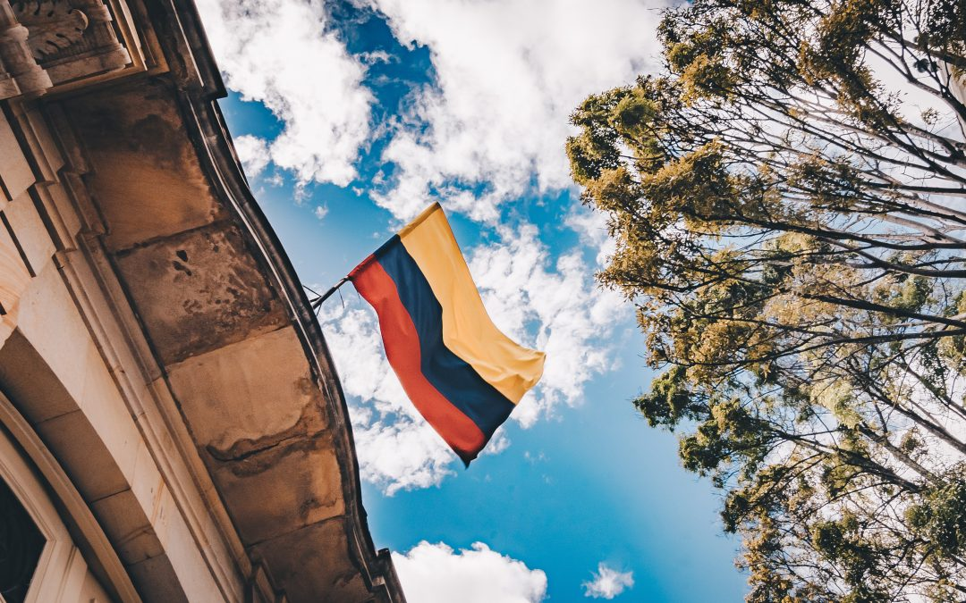 Colombia Flag in front of blue sky